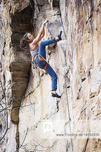 Teenage girl rock climbing