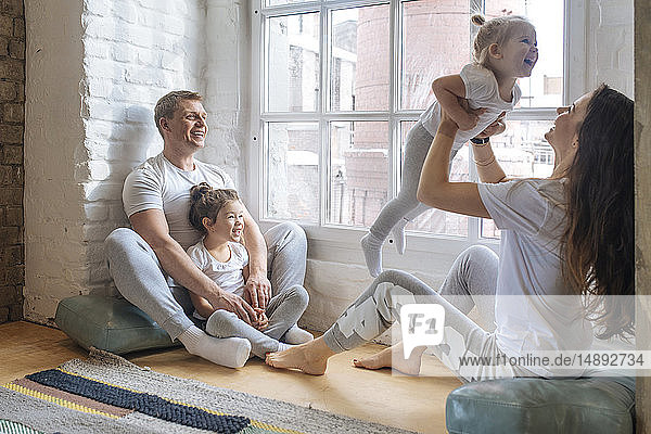 Family sitting by window