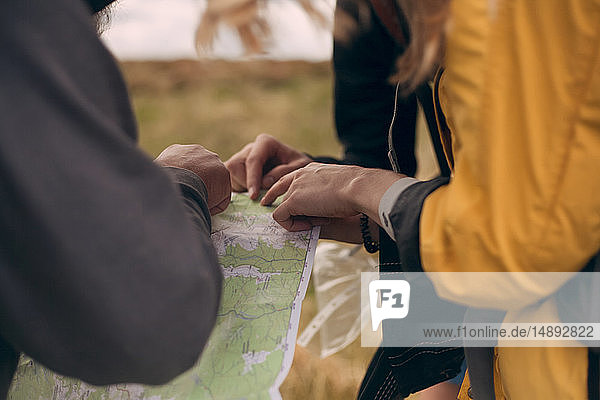 Hiking couple looking at map