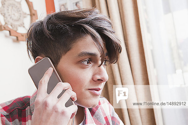 Portrait of teenage boy on phone call