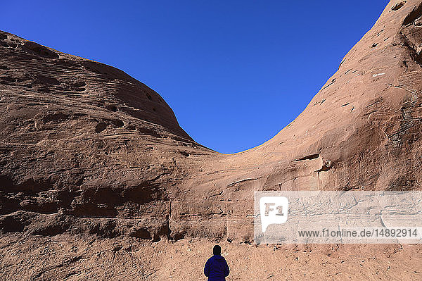Silhouette of woman by rock formation in Monument Valley  Arizona  USA