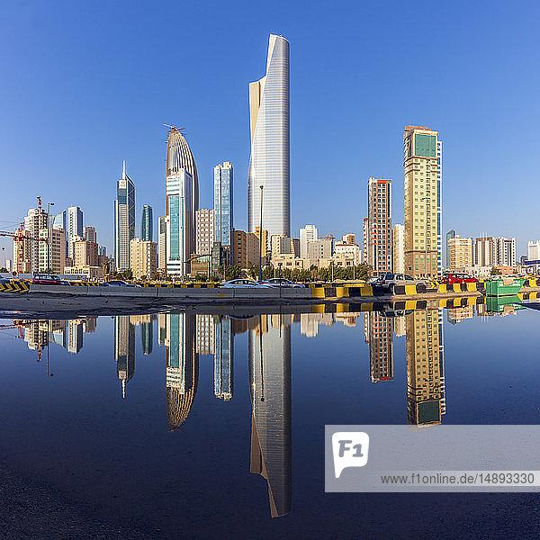 Skyline reflected in sea in Kuwait City  Kuwait