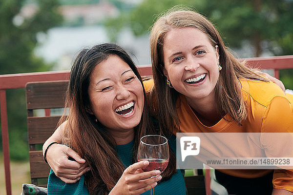 Cheerful friends enjoying party on terrace
