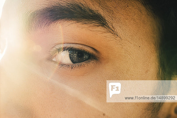 Close-up portrait of teenage boy during sunny day