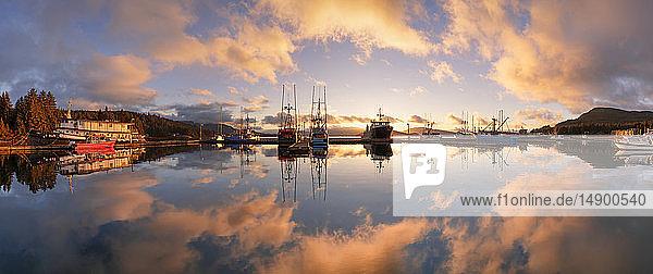 Commercial fishing boats in Auke Bay at sunset  Southeast Alaska; Juneau  Alaska  United States of America