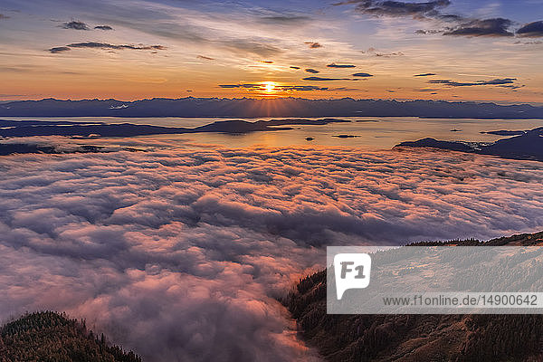 View across Lynn Canal from above Herbert Glacier and Chilkat Mountains at sunset  Southeast Alaska; Alaska  United States of America