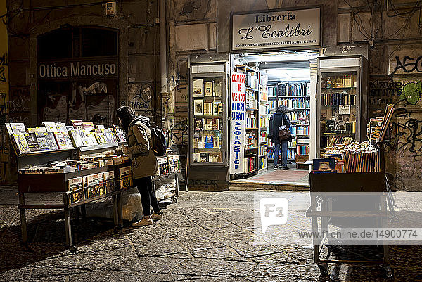 Books being displayed outside a bookshop in Naples old quarter; Naples  Italy