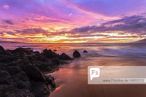 Dramatic beach sunset with soft water; Makena  Maui  Hawaii  United States of America
