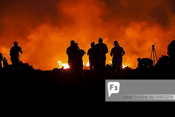 Photographers at the Kilauea volcano May 2018 eruption  East Rift Zone  Leilani Estates subdivision; Pahoa  Island of Hawaii  Hawaii  United States of America