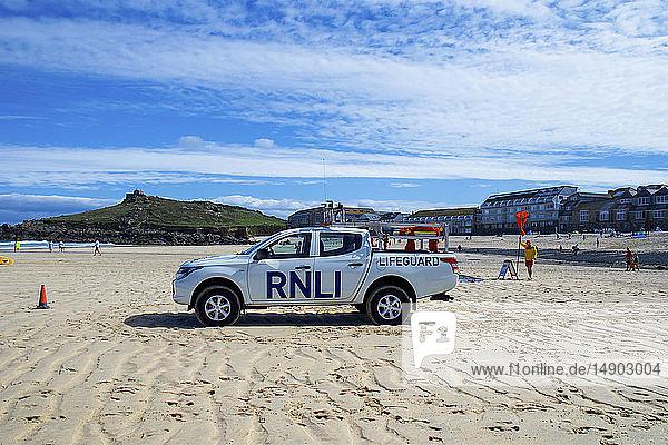 Lifeguarding vehicle and lifeguard on St. Ives Beach; Cornwall  England