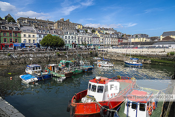 Fishing boats moored in the harbour; Cobh  County Cork  Ireland
