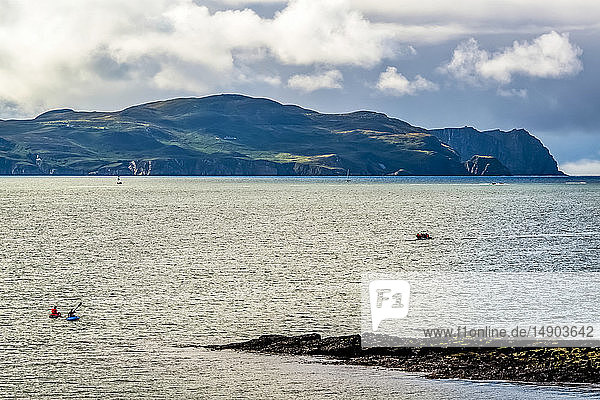 Kayaks and a boat in Sheephaven Bay; Downings  County Donegal  Ireland