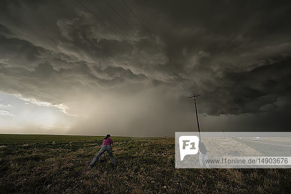 People photographing a supercell thunderstorm during a storm chasing tour; Oklahoma  United States of America