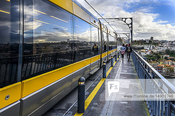 Passenger cars on a rail transit train on the Dom Luis I Bridge  the icon for Porto; Porto  Portugal