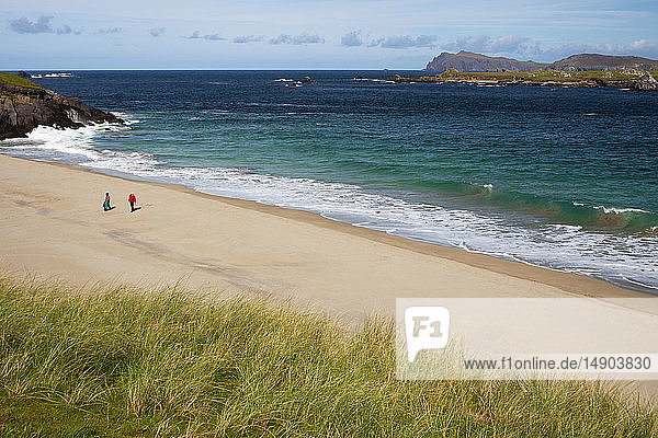 Two people walk on the beach of Great Blasket Island on the Dingle Peninsula  Wild Atlantic Way; Great Blasket Island  County Kerry  Ireland
