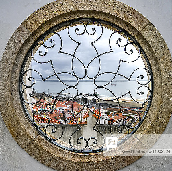 View through a round window of the Tejo river and Alfama District from the Miradouro de Santa Luzia; Lisbon  Lisboa Region  Portugal