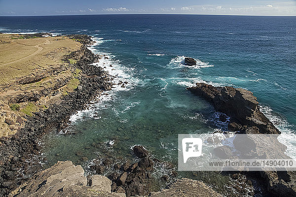 Rocky shoreline near Papakolea beach  also known as Green Sand Beach  near South Point  Kau district; Island of Hawaii  Hawaii  United States of America