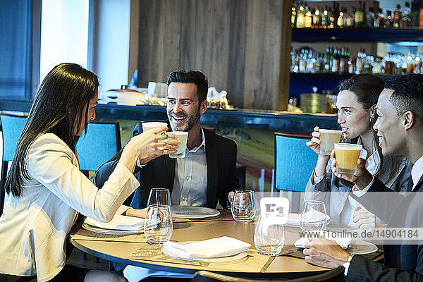 Business people drinking beer in bar