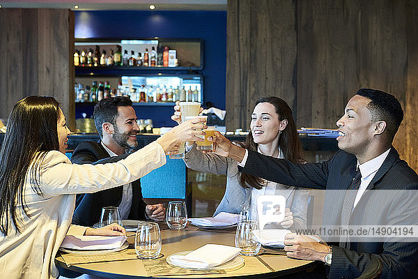 Business people toasting drink in bar