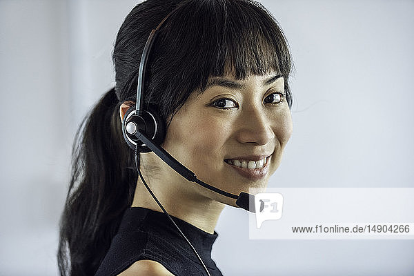 Portrait of businesswoman wearing headset