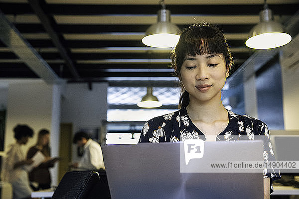 Businesswoman using laptop