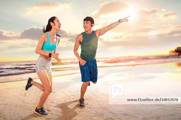 Young couples running on the beach