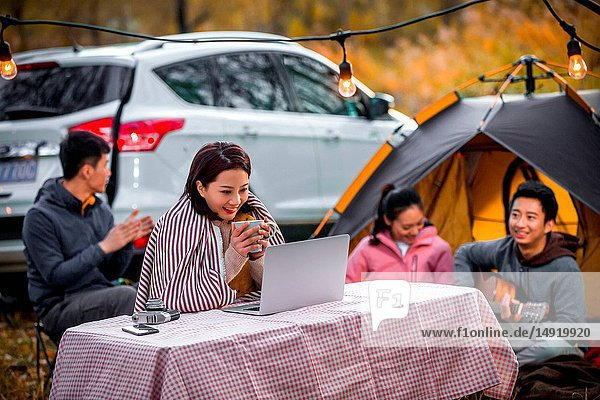 Young men and women in the outdoor camping