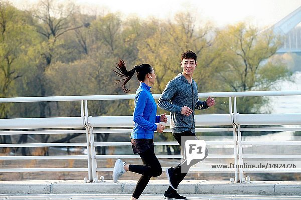 Young couples outdoor jogging