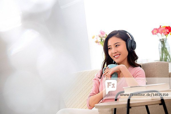 Happy young woman to listen to music