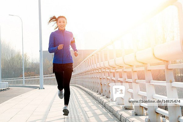 Young woman outdoor jogging