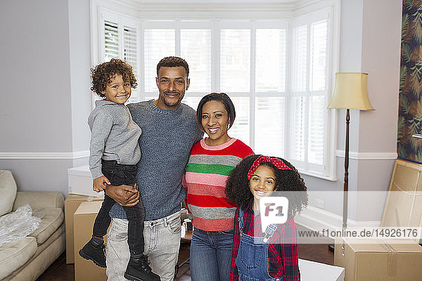 Portrait happy family moving house