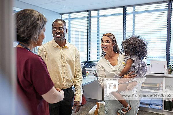 Doctor talking with family in clinic doctors office