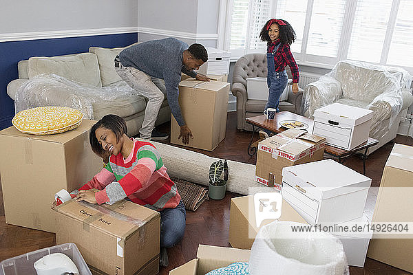 Family packing moving boxes  moving house