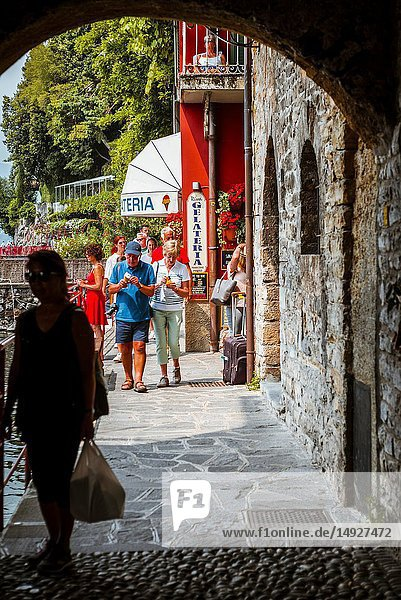 Street with arches in the center of Varenna  Province of Lecco  Lombardy  Italy  Europe.