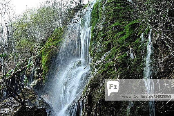 A waterfall on the Source of the River Cuervo Natural Monument. Serrania de Cuenca Natural Park. Cuenca Province,  Spain.