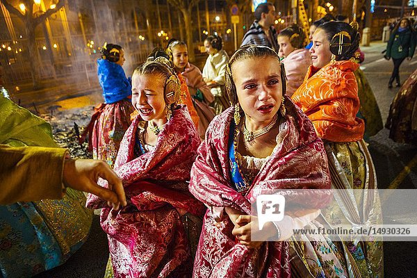Fallas festival. Falleras. Women in traditional dress. La Crema. The Burning. On 19 March all of the sculptures go up in flames. Burning in the St Joseph night. Valencia. Valencian Community. Spain.