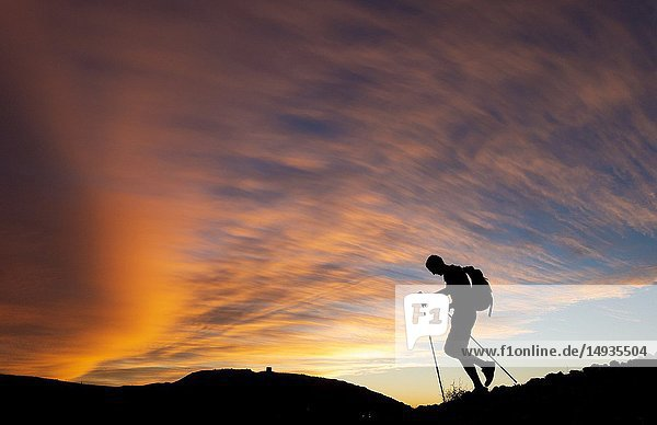 Gran Canaria  Canary Islands  Spain. Male hiker on mountain summit at sunrise.