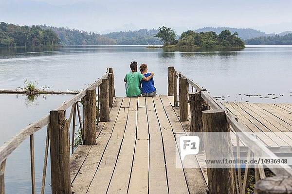 Laos  Sainyabuli  Elephant Conservation Center  couple on Nam Tien Reservoir pier  MR-LAO-ECC-18-005  MR-LAO-ECC-18-006.