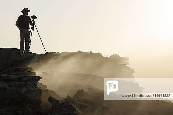 Photographer. Erta Ale volcano in Danakil Depression desert in Ethiopia. Africa.