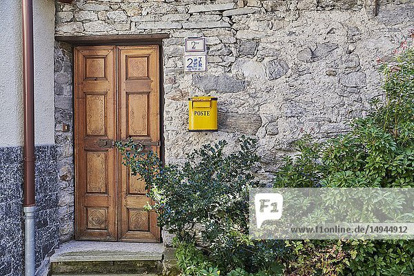 Home entrance in the old town of Craveggia with roofs made of slate rock. Province of Verbano-Cusio-Ossola. Piedmont. Italy.