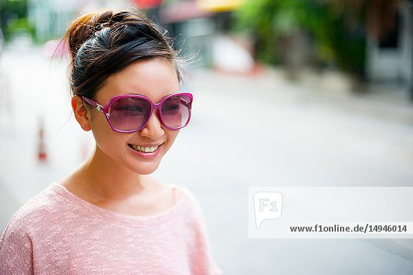 Japanese girl poses for pictures in Bangkok  Thailand.