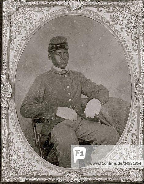 Seated black soldier  frock coat  gloves  kepi
