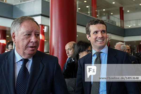 President of the Executive Committee of Ifema  Clemente González(l) and Pablo Casado entering through the main door to the FITUR fairgrounds. The leader of the Popular Party  PP  Pablo Casado has visited the fair of FITUR accompanied by leaders of the Popular Party.