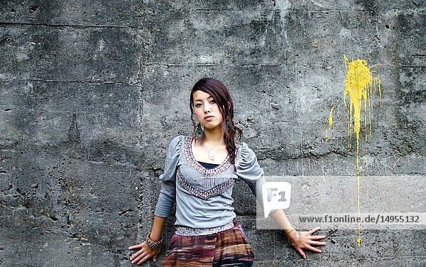 Japanese Girl poses on the street in Nakameguro  Japan. Nakameguro is a town located in the nice area of Tokyo.