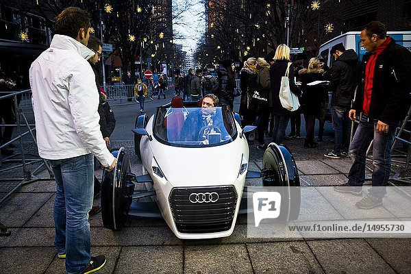 A man in an Audi concept car outside the Potsdamer Platz Theatre in Berlin  Germany.