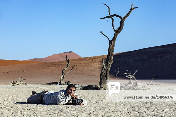 Photographer in Deadvlei - Namib-Naukluft National Park  Namibia  Africa.