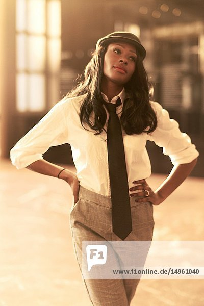 Stylish retro business woman wearing individual outfit indoors  African Angolan descent