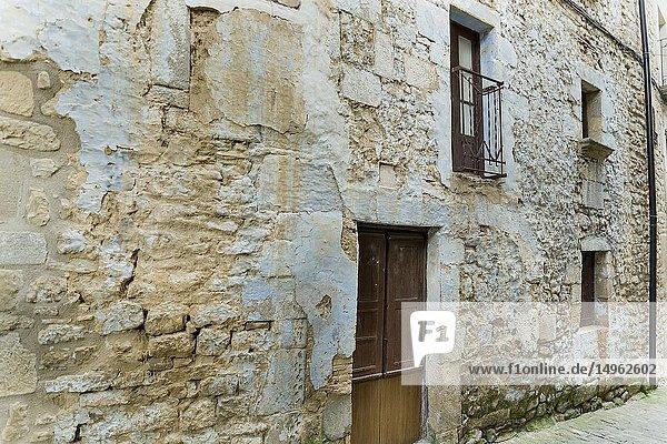 Old facade with door and windows at Sos del Rey Catolico. Zaragoza. Aragon. Spain. Europe.