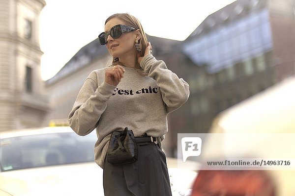 Fashionable blogger woman at street  streetstyle  in city Munich  Bavaria  Germany.