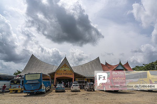 Long distance buses stopped at Roda Minang Cafe for lunch at Sosok  West Kalimantan  Indonesia